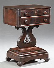 American Classical Revival Carved Mahogany Work Table, 19th c., the rectangular top over two drawers, on a pierced lyre form support...
