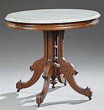American Eastlake Carved Mahogany Marble Top Center Table, late 19th c., the highly figured oval white marble on carved serpentine q...