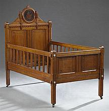 American Aesthetic Movement Carved Walnut Child's Bed, late 19th c., probably New York, in the school of the Herter Bros., the medal...