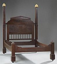 American Classical Revival Carved Mahogany Poster Bed, late 19th c., the tapered posts flank a pointed arched headboard joined by tw...