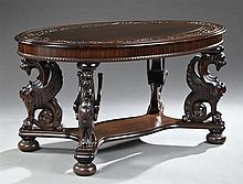 American Renaissance Revival Carved Mahogany Library Table, c. 1900, New York, attributed to R.J. Horner, the oval top above a wide...
