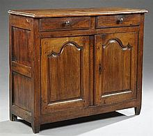 French Provincial Louis XIV Style Carved Walnut Sideboard, mid 19th c., the rectangular stepped edge top over two frieze drawers abo...