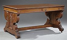 Belgian Renaissance Style Carved Walnut Library Table, early 20th c., the rectangular top over a wide skirt, with two opposing long...