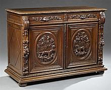 French Henri II Style Carved Oak Buffet, 19th c., the rectangular top over two frieze drawers above two medallion carved cupboard do...