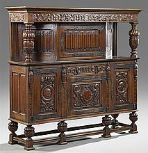 French Jacobean Style Carved Oak Court Cupboard, late 19th c., the stepped crown above a carved linen fold cupboard door with like c...