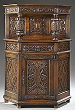 Jacobean Style Carved Oak Court Cupboard, 19th c., the stepped crown over a shield carved back flanked by foliate carved tapered col...