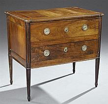 French Louis XVI Style Carved Walnut Commode, 19th c., the rectangular cookie corner top over two drawers flanked by fluted stiles,...