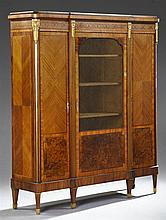Louis XVI Style Ormolu Mounted Marquetry and Parquetry Inlaid Rosewood and Walnut Bibliotheque, early 20th c., the stepped breakfron...