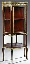 Carved Mahogany Ormolu Mounted Marble Top Curved Glass Vitrine, early 20th c., the galleried highly figured brown marble over an orm...
