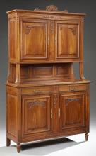 French Art Nouveau Carved Cherry Buffet a Deux Corps, late 19th c., the arched fruit crest above double fielded panel cupboard doors...
