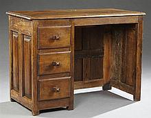 French Louis XIII Style Carved Oak Coffer Desk, 19th c. and later, the stepped rectangular top over a kneehole flanked left by three...