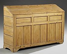Southern American Vernacular Carved Pine Slant Front Grain Bin, 19th c., the three slanting tops lifting to a double compartmented i...