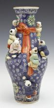 Chinese Baluster Porcelain Vase, early 20th c., with applied climbing figural decoration, H.- 9 5/8 in., Dia.- 5 in.