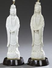 Pair of Oriental Blanc de Chine Porcelain Female Figures, late 19th c., now mounted on sloping wooden bases as table lamps, H.- 20 i...