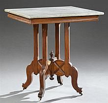 American Eastlake Carved Walnut Granite Top Lamp Table, late 19th c., the square highly figured granite over a wide skirt on a quadr...