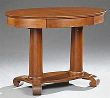 American Empire Style Carved Mahogany Center Table, late 19th c., the oval top above a frieze drawer on double tapered cylindrical s...