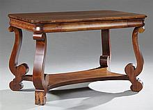American Classical Revival Carved Mahogany Library Table, late 19th c., the rectangular top over a cavetto skirt with a frieze drawe...