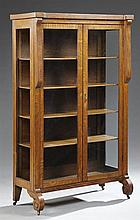 American Arts and Crafts Carved Oak Curio Cabinet, 20th c., the breakfront top over two glazed doors flanked by glazed panel sides,...