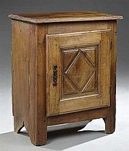 French Provincial Louis XII Style Carved Oak Confiturier, 19th c., the stepped edge rectangular top over a raised panel cupboard doo...