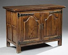 French Provincial Louis XIII Style Carved Walnut Sideboard, 20th c., the rectangular top over two fielded panel cupboard doors with...