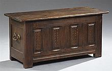 French Provincial Carved Oak Coffer, late 19th c., the rectangular top opening over a raised panel front flanked by ormolu mounted s...