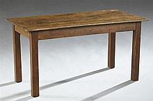 French Provincial Kitchen Table, 19th c., the rectangular top over a wide skirt on square tapered legs, now cut down for use as a co...
