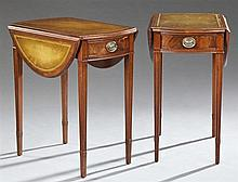 Pair of American Sheraton Style Carved Mahogany Leather Top Drop Leaf End Tables, mid 20th c., the inset gilt tooled leather oval to...