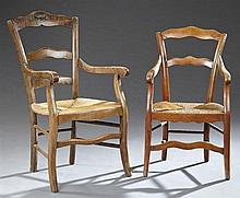 Two French Provincial Louis Philippe Ladder Back Fauteuils, 19th c., the serpentine crest rails over horizontal splats above woven r...