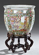 Chinese Style Famille Rose Porcelain Baluster Fishbowl, 20th c., the exterior with panel decorations of interior scenes and flowers,...