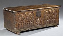 French Gothic Style Carved Oak Coffer, early 19th c., the rectangular top over a quatrefoil and lancet carved front with a large wro...