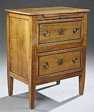 French Provincial Louis XVI Style Carved Walnut Bachelor's Chest, 19th c., the rectangular top over a pull out brushing slide above...