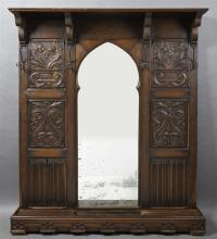 French Renaissance Style Carved Oak Hall Tree, 19th c., the rectangular shelf over a central Gothic shaped mirror flanked by four ir...