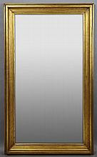 Large Contemporary French Empire Style Giltwood Overmantel Mirror, 20th c., the wide stepped molded frame around a beveled rectangul...