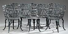 Eight Piece Art Nouveau Cast Aluminum Garden Set, 20th c., consisting of a small table and 7 armchairs with sunflower and scrolling...