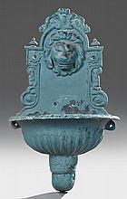 Baroque Style Polychromed Cast Iron Lavabo, 20th c., the arched crest with a relief lion mask above a demilune campana form reservoi...