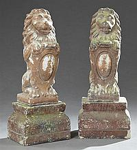 Pair of Regency Style Cast Stone Garden Lions on Stands, 20th c., seated on their hind legs holding a shield, on stepped tapered rec...