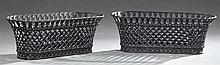 Pair of Late Victorian Cast Iron Reticulated Planters, c. 1900, of oval basket weave form, in black paint, H.- 12 in., W.- 33 3/4 in...