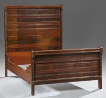 American Eastlake Carved Mahogany Bed, c. 1900, the headboard with incised decoration, joined by two serpentine bracket form rails t...