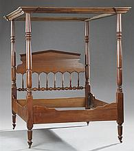 American Late Victorian Carved Mahogany Canopy Bed, 19th c., the shaped stepped tester on turned tapered posts joining a pointed spi...
