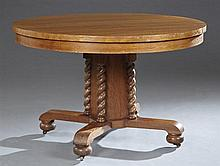 American Carved Oak Arts and Crafts Circular Dining Table, c. 1910, the top over a wide skirt, on a square support with barley twist...
