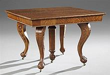 American Arts and Crafts Carved Tiger Oak Ball and Claw Dining Table, c. 1900, the square top on foliate carved decorated cabriole l...