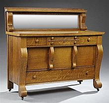 American Arts and Crafts Oak Sideboard, c. 1900, the wide beveled mirror back with scrolled supports, on a base with two central sha...