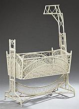 American Late Victorian Polychromed Bent Wicker Baby's Cradle, c.1900, the canopy over a pierced rocking cradle, on splayed legs joi..