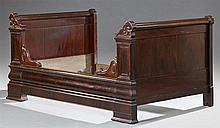 French Empire Carved Mahogany Lit du Coin, 19th c., the triple crested ends on stepped scrolled supports, H.- 39 1/4 in., W.- 46 in....