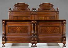 Pair of Continental Carved Walnut Single Beds, 19th c., now joined to make a king size bed, the arched headboards with twist turned...
