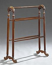 American Turned Walnut Towel Rack, late 19th c., arched trestle sides joined by turned rails, on splayed legs, H.- 31 in., W.- 25 3/...