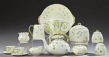 Group of Fourteen Pieces of Belleek, consisting of a pitcher, a biscuit barrel, a small vase, two cups and two saucers, all with bro...