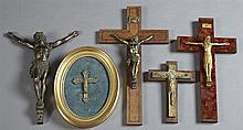 Group of Five Crucifixes, early 20th c., consisting of a bronze crucifix figure lacking its cross, two of mahogany, one of walnut, o...