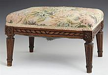 Louis XVI Carved Mahogany Upholstered Footstool, early 20th c., with a carved skirt with floral block corners on tapered turned legs...