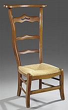 French Provincial Carved Walnut Rush Seat Prie Dieu, late 19th c., the tapered ladder back with a curved armrest over serpentine sha...